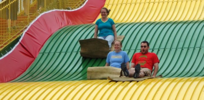three people on the giant slide
