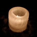 cylinder ice candle with a flame partially visible
