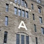 angled view of a brick building with the words PILLSBURY A