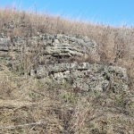 rock outcropping in grassland in late autumn