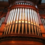 the tall pipes above an organ