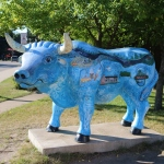 blue ox with many small paintings of town icons