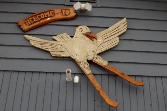 wooden decoration of a seagull skiing