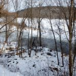 overlooking the frozen, snow-covered St. Croix River, a bit of open water in the foreground